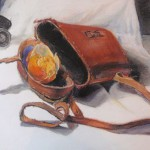 Shamor's drawing of an orange in a binoculars case